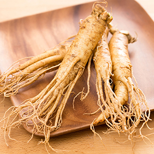 77517156 - fresh ginseng on wooden plate